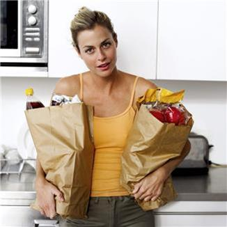woman with 2 grocery bags
